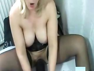 Fucking Herself With A Hefty Black Faux-cock